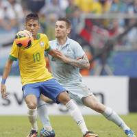 Brazil earns rare victory over France