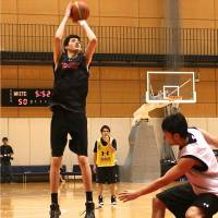Stepping up: Yuta Watanabe, working on his jump shot at the Ajinomoto National Training Center, plans to attend a Connecticut preparatory school before aiming to land a spot on an NCAA Division I men's basketball team. | KAZ NAGATSUKA