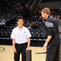 Season to remember: Nobuhisa Yoshida, San Antonio's strength and conditioning coach, works with Spurs big man Matt Bonner during the season. | D. CLARKE EVANS/NBAE/GETTY IMAGES