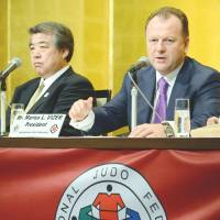Get it together: International Judo Federation president Marius Vizer (right) and All-Japan Judo Federation president Haruki Uemura answer questions on Monday. | AFP-JIJI