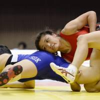 Locked up: Kaori Icho (right) competes in the women's 63-kg competition at the All-Japan Invitational Championships in Tokyo on Sunday. | KYODO