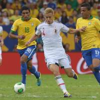 Must do better: Keisuke Honda and his Japan teammates will be hoping to do better against Italy in the Confederations Cup on Wednesday than they did last weekend against Brazil. | AFP-JIJI