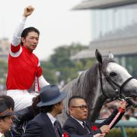 Ship ahoy: Jockey Hiroyuki Uchida celebrates atop Gold Ship after winning the Takarazuka Kinen on Sunday. | KYODO