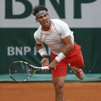 Nadal rallies again for win
