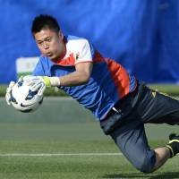 Looking forward: Japan goalkeeper Eiji Kawashima wants to forget about his mistake in last week's 2-0 defeat to Bulgaria and concentrate on Tuesday's World Cup qualifier against Australia. | KYODO