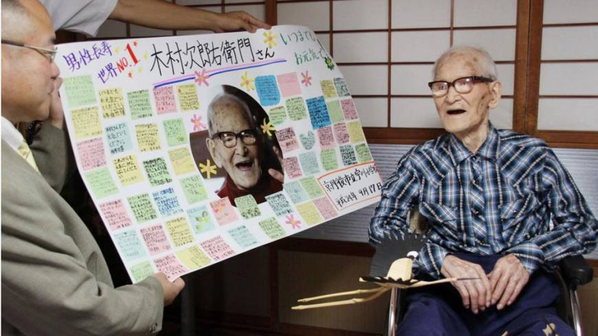 Good innings: Jiroemon Kimura, the world's oldest person, receives messages written by students of a local elementary school in Kyotango, Kyoto Prefecture, last Sept. 17. Kimura died Wednesday at the age of 116.
