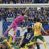 Out of reach: Japan goalkeeper Eiji Kawashima can't stop Australia midfielder Tommy Oar's shot in the 81st minute on Tuesday.  | KYODO