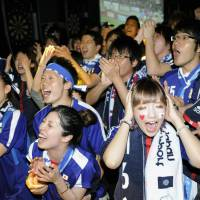 Festive night: Throughout Japan, including at a sports bar in Shibuya Ward, Tokyo, soccer fans gather to watch Tuesday's Japan-Australia World Cup qualifier.  | KYODO