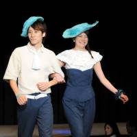 A couple representing Columbia model in the 'Why Blue' fashion show for World Refugees Fashion, at Laforet Museum Harajuku.  | SATOKO KAWASAKI