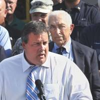 Final act: Democratic New Jersey Sen. Frank Lautenberg (right) listens as state Gov. Chris Christie addresses a gathering in Lincoln Park, New Jersey, in August 2011. | AP