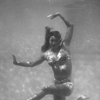 Aqua ballerina: Esther Williams poses in a publicity photo for the film 'Pagan Love Song' in 1950. Right: Williams rehearses for 'Ziegfeld Follies' in 1944. | AP