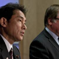 Japan's Foreign Affairs Minister Fumio Kishida answers a question Sunday at a joint press conference in Auckland  with his New Zealand counterpart Murray McCully. | AFP-JIJI