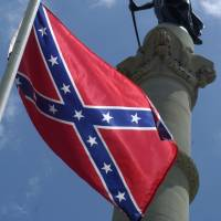 Symbolic: A Confederate flag flies next to a Civil War monument on the grounds of the State Capitol building in Montgomery, Alabama, in 2005. | BLOOMBERG