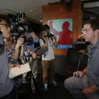 Major scoop: Guardian reporter Glenn Greenwald speaks to reporters in Hong Kong on Monday about his interview with Edward Snowden. | AP