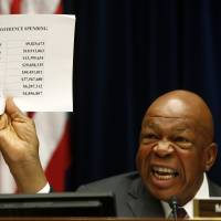 Case closed?: Rep. Elijah Cummings, ranking Democrat on the  House Oversight and Government Reform Committee, holds up a sheet detailing IRS conference spending as he makes opening remarks on Capitol Hill in Washington on  Thursday. | AP