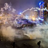 Battle lines drawn:  Turkish police flood  Taksim Square with tear gas as they clashed with angry protesters into the night in Istanbul on  Tuesday. | AP