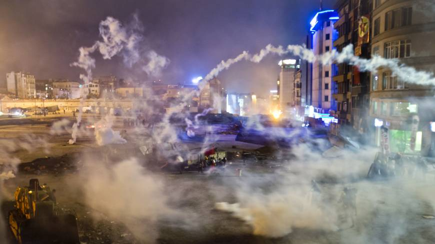 Battle lines drawn:  Turkish police flood  Taksim Square with tear gas as they clashed with angry protesters into the night in Istanbul on  Tuesday.