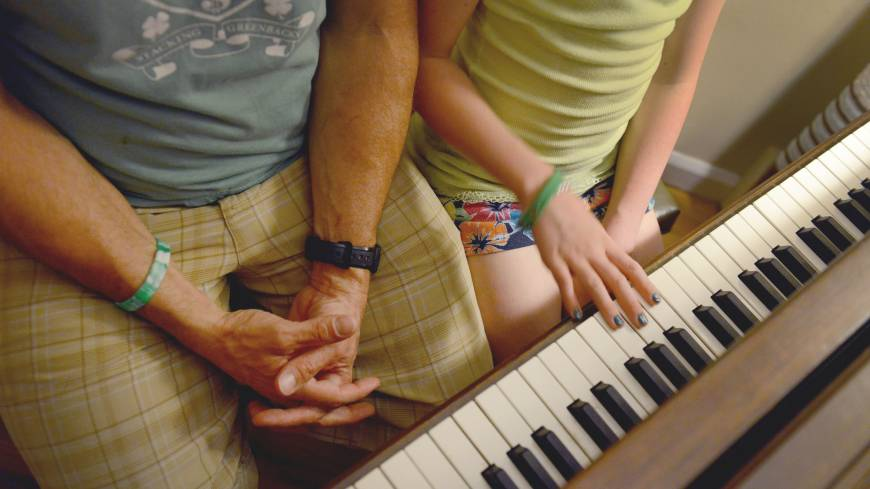 After the violence: Mark Barden and his daughter Natalie, 11, go over her piano lessons together at their home in Newtown, Connecticut, on May 23.