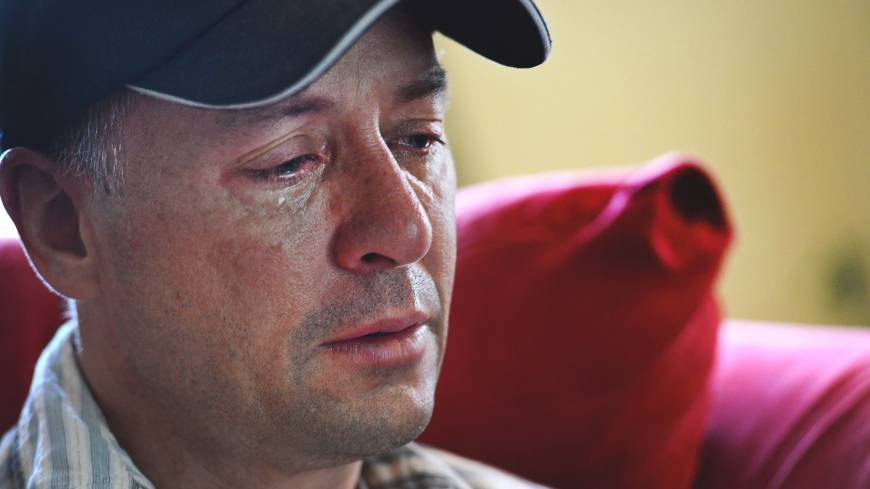 Never-ending tears: Mark Barden weeps as he recalls memories of his slain son, Daniel, in Newtown, Connecticut on May 23. Daniel was among the schoolchildren killed in last December's Newtown shootings.