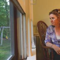 Jackie Barden stares off into the backyard where Daniel used to play on a swing set. | THE WASHINGTON POST