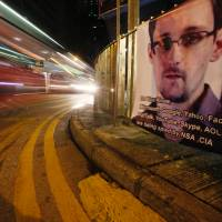 Snowden defends leaks, denies spying for China