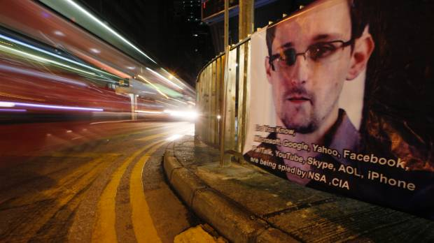 Snowden defends leaks, denies spying