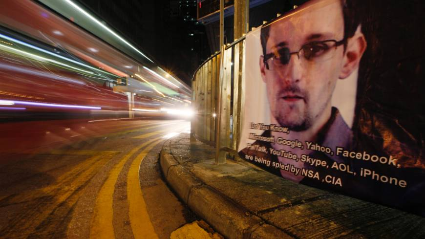 Banner achievement: A bus drives past a banner supporting Edward Snowden, a former CIA employee and NSA contractor who leaked top-secret documents about sweeping U.S. surveillance programs, in Hong Kong on Tuesday.