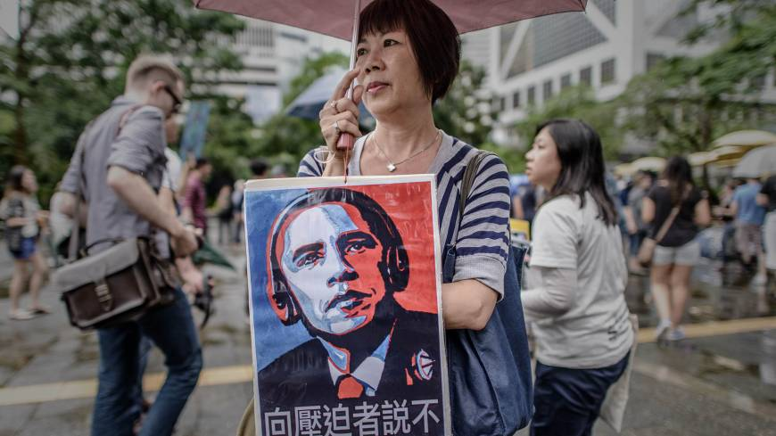 A woman holds a placard near the U.S. consulate in Hon Kong during a protest march in support of Edward Snowden.
