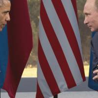 Old-school rivals: U.S. President Barack Obama meets Russian leader  Vladimir Putin in Enniskillen, Northern Ireland, on Monday. | AP