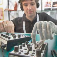 Bionic man: Born without a left hand, Bertolt Meyer received a bionic hand developed by Scottish company Touch Bionics at the age of 19. Here he operates a music console in 2010 at the Orthopedic and Rehabilitation Technology fair in Germany. | AP