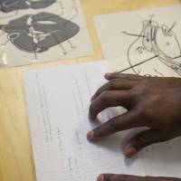 Aiding the blind: Korey Singleton, who manages the George Mason University Assistive Technology Initiative, demonstrates a tactile diagram on fetal pig dissection for students in Fairfax, Virginia, on June 14.   THE WASHINGTON POST