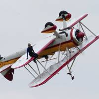 Wing walker, pilot die in biplane crash at Ohio air show