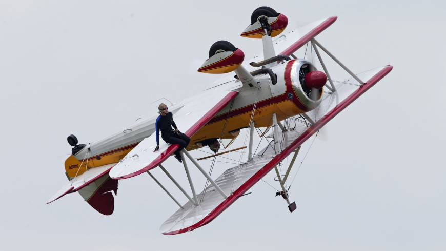 Air show tragedy: Wing walker Jane Wicker performs at the Vectren Air Show just before the plane crashed Saturday in Dayton, Ohio.