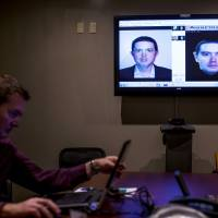 Digital detective: A method of facial mapping is demonstrated in Clearwater, Florida, on June 4 by Scott McCallum, systems analyst and co-administrator of the facial recognition program for the Pinellas County Sheriff's Office. | THE WASHINGTON POST
