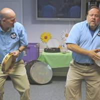 Machine drum: Adam Mason (left) and Alan Yellowitz lead a rhythm enhancement session at Arden Courts Memory Care Community, home to a number of Alzheimer's patients, in Annandale, Virginia, earlier this month. | THE WASHINGTON POST