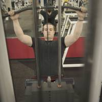 Getting back in shape: Spencer works out at the gym in suburban Houston. At 183 cm tall and 113 kg, Spencer sometimes enjoys working out, but his mother worries that it also may be a manifestation of a manic phase. | THE WASHINGTON POST