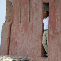 Centuries of shame: President Barack Obama looks out of the Door of No Return during a tour of Goree Island in Senegal on  Thursday. | AP
