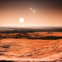 Triple super: This ESO illustration shows the exoplanet Gliese 667C in a triple-star system. | AFP-JIJI