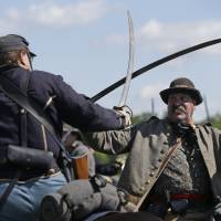 Turning point: A cavalry battle is re-enacted during activities commemorating the 150th anniversary of the Battle of Gettysburg on Saturday at Bushey Farm in Gettysburg, Pennsylvania. | AP
