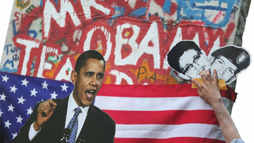 Opened secrets: Activists hold up photos of U.S. President Barack Obama, former U.S. NSA contractor Edward Snowden (center) and army whistle-blower Pfc. Bradley Manning during a June 19 protest in Berlin.