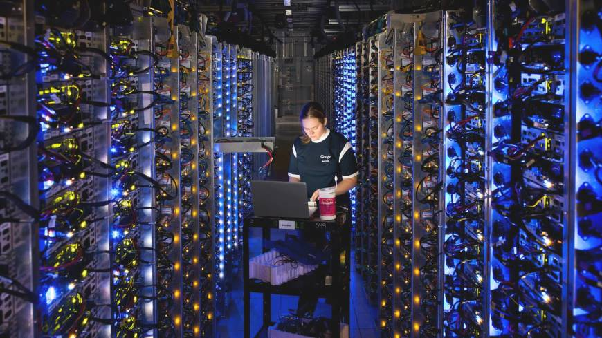 Heart of the matter: A Google technician diagnoses an overheated computer processor at the Internet giant's data center in The Dalles, Oregon. Google uses these data centers to store email, photos, video, calendar entries and other information shared by its users. These centers also process the hundreds of millions of searches that Internet users make on the website each day.