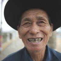 Several years left: An elderly man has a laugh outside a tea house in Chengmai, Hainan province, in January.   AFP-JIJI