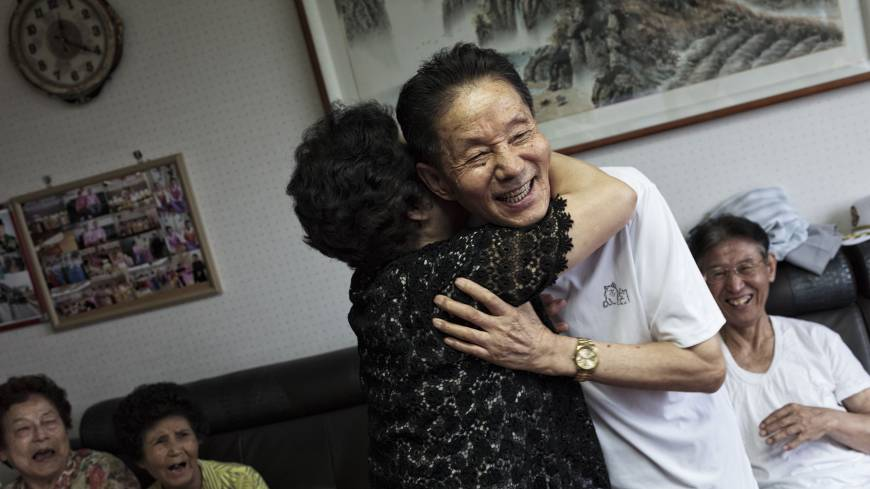 Emotional time: Park Hyang-sook (left), who escaped from North Korea in 2006 with the remains of her late husband, a prisoner of war from South Korea, embraces Lee Gyu-il, 80, a POW who escaped the North in 2008.
