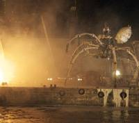 One of the spiders departs on a fiery barge during the finale of La Machine's performance April 19. | MIO YAMADA PHOTO