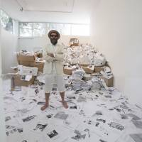 Internet printed: U.S. poet Kenneth Goldsmith stands with 10 tons of printed Web pages from the 'Printing Out the Internet' exhibit he's coordinating at the Labor art gallery in Mexico City. | AFP-JIJI