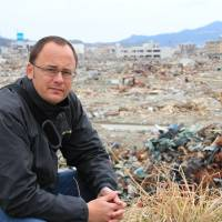 On location: Tokyo-based Australian journalist Mark Willacy, author of 'Fukushima' (published 2013 by Macmillan Australia), visits the devastated coastal town of Rikuzentakata, Iwate Prefecture, in March 2011. | COURTESY OF MARK WILLACY