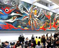 Crowdpleaser: A small throng of people gazes at 'Myth of Tomorrow' by Taro Okamoto on show at Shibuya Markcity in central Tokyo in November 2008. A new study suggests that increasing population density sparked the emergence of modern human behavior. | SATOKO KAWSAKI PHOTO