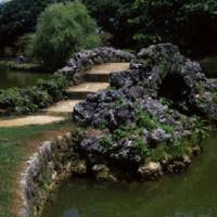 Shapely span: Chinese style and Okinawan exuberance combine in this charming humped bridge made of coral limestone. Like the rest of Shikina-en Garden, which was obliterated by bombing in World War II, this bridge was reconstructed using much of its original material.