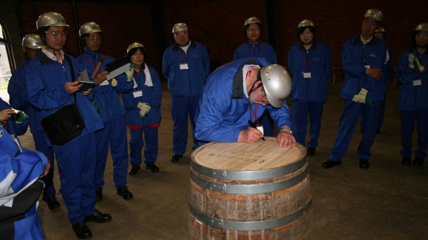 Sign of hope: Higashi-Matsushima folk look on as I inscribe their 'My Whisky' barrel.