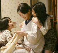 Kayo, played by Sayuri Yoshinaga, with family in 'Kaabee'